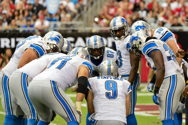 Sep 15, 2013; Phoenix, AZ, USA; Detroit Lions quarterback Matthew Stafford (9) huddles with teammates during the second half against the Arizona Cardinals at University of Phoenix Stadium. Mandatory Credit: Matt Kartozian-USA TODAY Sports