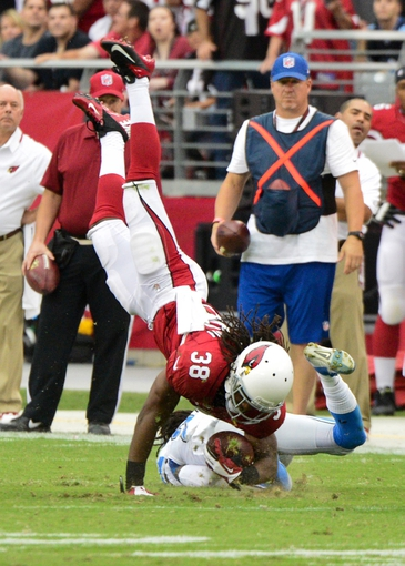 Sep 15, 2013; Phoenix, AZ, USA; Arizona Cardinals running back Andre Ellington (38) makes a catch as Detroit Lions cornerback Bill Bentley (28) defends during the second half at University of Phoenix Stadium. Mandatory Credit: Matt Kartozian-USA TODAY Sports
