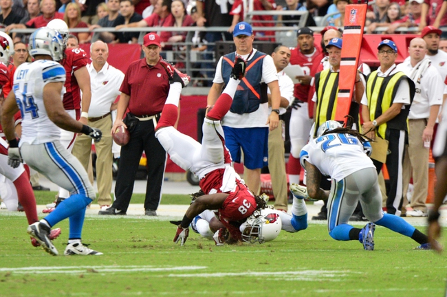 Sep 15, 2013; Phoenix, AZ, USA; Arizona Cardinals running back Andre Ellington (38) makes a catch as Detroit Lions cornerback Bill Bentley (28) and free safety Louis Delmas (26) defend during the second half at University of Phoenix Stadium. Mandatory Credit: Matt Kartozian-USA TODAY Sports