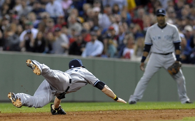 Sep 15, 2013; Boston, MA, USA; New York Yankees shortstop Brendan Ryan (35) dives for a ground ball to start a double play during the third inning against the Boston Red Sox at Fenway Park. Mandatory Credit: Bob DeChiara-USA TODAY Sports