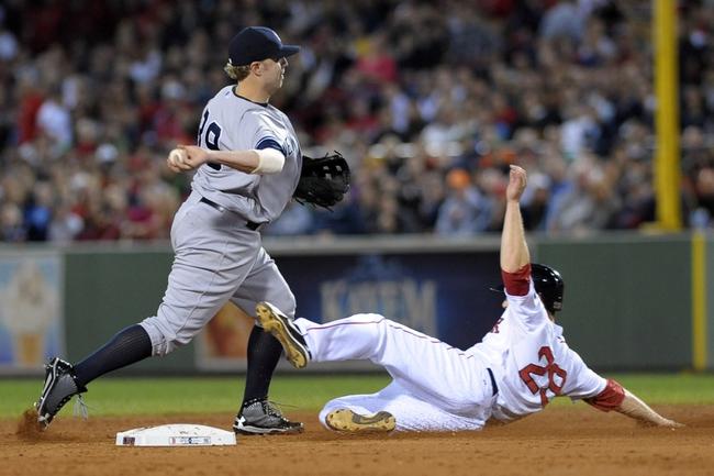 Sep 15, 2013; Boston, MA, USA; New York Yankees third baseman Mark Reynolds (39) forces Boston Red Sox right fielder Daniel Nava (29) out at second base and turns a double play during the third inning at Fenway Park. Mandatory Credit: Bob DeChiara-USA TODAY Sports