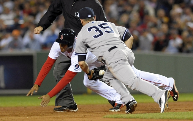 Sep 15, 2013; Boston, MA, USA; Boston Red Sox third baseman Xander Bogaerts (rear) slides past the tag of New York Yankees shortstop Brendan Ryan (35) during the fourth inning at Fenway Park. Mandatory Credit: Bob DeChiara-USA TODAY Sports