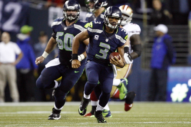 Sep 15, 2013; Seattle, WA, USA; Seattle Seahawks quarterback Russell Wilson (3) scrambles against the San Francisco 49ers during the second quarter at CenturyLink Field. Mandatory Credit: Joe Nicholson-USA TODAY Sports