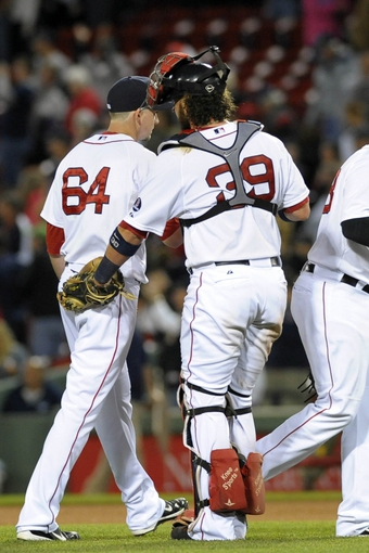 Sep 15, 2013; Boston, MA, USA; Boston Red Sox catcher Jarrod Saltalamacchia (39) congratulates relief pitcher Allen Webster (64) after defeating the New York Yankees  at Fenway Park. Mandatory Credit: Bob DeChiara-USA TODAY Sports