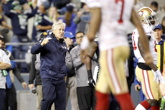 Sep 15, 2013; Seattle, WA, USA; Seattle Seahawks head coach Pete Carroll celebrates following a turnover by the San Francisco 49ers during the fourth quarter at CenturyLink Field. Mandatory Credit: Joe Nicholson-USA TODAY Sports