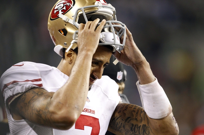 Sep 15, 2013; Seattle, WA, USA; San Francisco 49ers quarterback Colin Kaepernick (7) puts his helmet on before a series against the Seattle Seahawks during the fourth quarter at CenturyLink Field. Mandatory Credit: Joe Nicholson-USA TODAY Sports