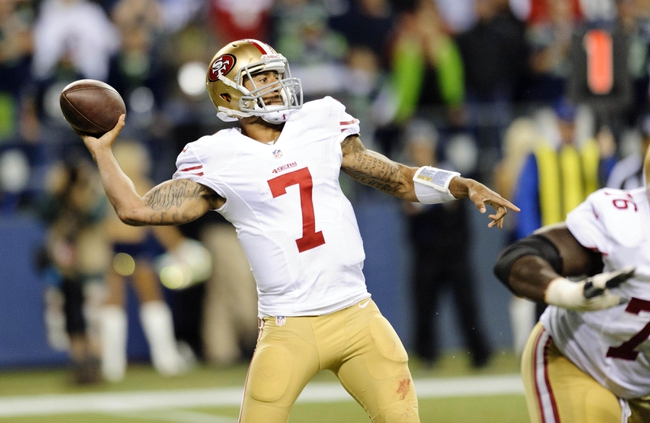 Sep 15, 2013; Seattle, WA, USA; San Francisco 49ers quarterback Colin Kaepernick (7) passes the ball against the Seattle Seahawks during the 2nd half at CenturyLink Field. Seattle defeated San Francisco 29-3. Mandatory Credit: Steven Bisig-USA TODAY Sports