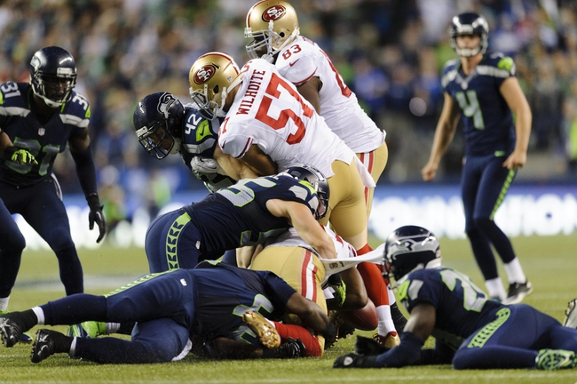 Sep 15, 2013; Seattle, WA, USA; San Francisco 49ers special teams player Perrish Cox (20) fumbles the ball on a kickoff during the 2nd half against the Seattle Seahawks at CenturyLink Field. Seattle defeated San Francisco 29-3. Mandatory Credit: Steven Bisig-USA TODAY Sports