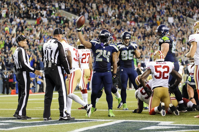 Sep 15, 2013; Seattle, WA, USA; Seattle Seahawks running back Marshawn Lynch (24) celebrates after scoring a touchdown against the San Francisco 49ers during the 2nd half at CenturyLink Field. Seattle defeated San Francisco 29-3. Mandatory Credit: Steven Bisig-USA TODAY Sports