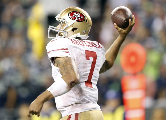 Sep 15, 2013; Seattle, WA, USA; San Francisco 49ers quarterback Colin Kaepernick (7) passes against the Seattle Seahawks during the fourth quarter at CenturyLink Field. Mandatory Credit: Joe Nicholson-USA TODAY Sports