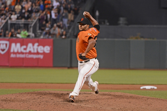 September 6, 2013; San Francisco, CA, USA; San Francisco Giants starting pitcher Yusmeiro Petit (52) delivers a pitch during the ninth inning against the Arizona Diamondbacks at AT&T Park. The Giants defeated the Diamondbacks 3-0. Mandatory Credit: Kyle Terada-USA TODAY Sports