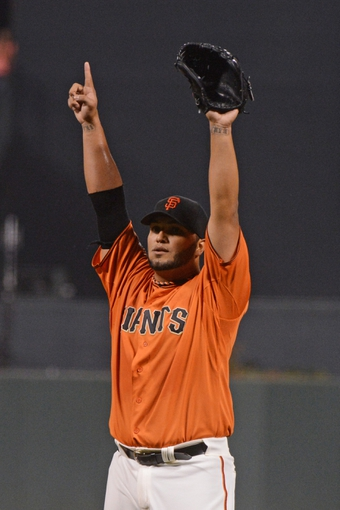 September 6, 2013; San Francisco, CA, USA; San Francisco Giants starting pitcher Yusmeiro Petit (52) celebrates after throwing a one-hit complete game against the Arizona Diamondbacks at AT&T Park. The Giants defeated the Diamondbacks 3-0. Mandatory Credit: Kyle Terada-USA TODAY Sports