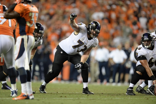 Sep 5, 2013; Denver, CO, USA; Baltimore Ravens guard Marshal Yanda (73) at the line of scrimmage in during the game against the Denver Broncos at Sports Authority Field at Mile High. Mandatory Credit: Ron Chenoy-USA TODAY Sports