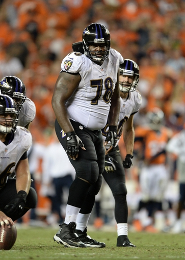 Sep 5, 2013; Denver, CO, USA; Baltimore Ravens tackle Bryant McKinnie (78) at the line of scrimmage in during the game against the Denver Broncos at Sports Authority Field at Mile High. Mandatory Credit: Ron Chenoy-USA TODAY Sports