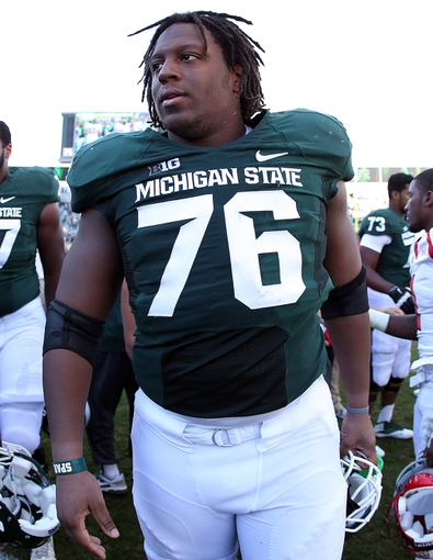 Sep 14, 2013; East Lansing, MI, USA; Michigan State Spartans offensive linesman Donavon Clark (76) celebrates a win after a game between the Michigan State Spartans and the Youngstown State Penguins at Spartan Stadium. Mandatory Credit: Mike Carter-USA TODAY Sports