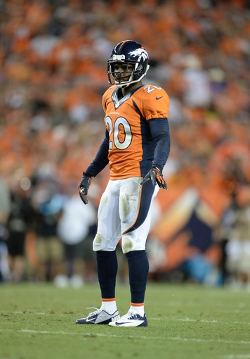 Sep 5, 2013; Denver, CO, USA; Denver Broncos strong safety Mike Adams (20) during the game against the Baltimore Ravens at Sports Authority Field at Mile High. Mandatory Credit: Ron Chenoy-USA TODAY Sports