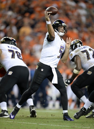 Sep 5, 2013; Denver, CO, USA; Baltimore Ravens quarterback Joe Flacco (5) passes during the game against the Denver Broncos at Sports Authority Field at Mile High. Mandatory Credit: Ron Chenoy-USA TODAY Sports