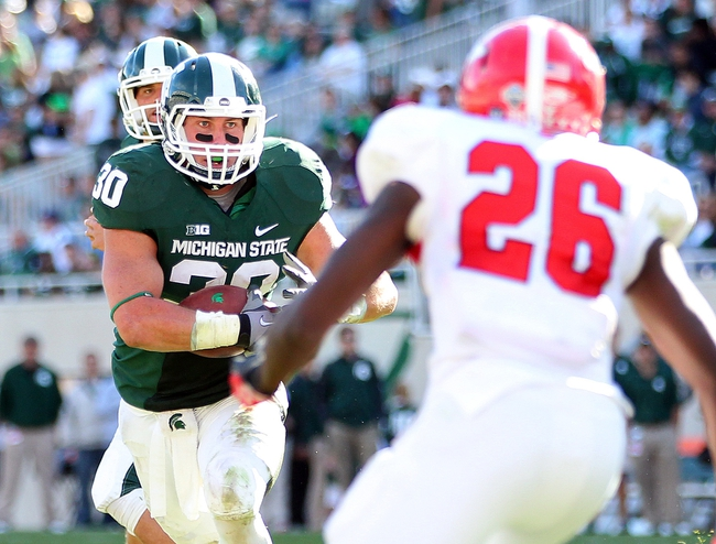 Sep 14, 2013; East Lansing, MI, USA; Michigan State Spartans running back Riley Bullough (30) runs the ball during the second half in a game at Spartan Stadium. MSU won 55-17.Mandatory Credit: Mike Carter-USA TODAY Sports