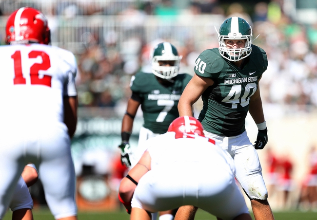 Sep 14, 2013; East Lansing, MI, USA; Michigan State Spartans linebacker Max Bullough (40) prepares for the snap of the ball during the first half in a game between the Michigan State Spartans and the Youngstown State Penguins at Spartan Stadium. Mandatory Credit: Mike Carter-USA TODAY Sports