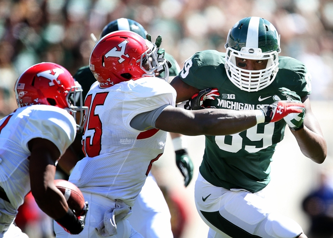 Sep 14, 2013; East Lansing, MI, USA; Michigan State Spartans defensive end Shilique Calhoun (89) runs against Youngstown State Penguins running back Torrian Pace (25) during the first half in a game at Spartan Stadium. Mandatory Credit: Mike Carter-USA TODAY Sports