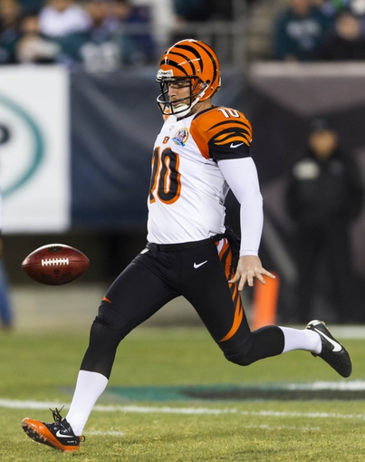 Dec 13, 2012; Philadelphia, PA, USA; Cincinnati Bengals punter Kevin Huber (10) punts the ball during the second quarter against the Philadelphia Eagles at Lincoln Financial Field. The Bengals defeated the Eagles 34-13. Mandatory Credit: Howard Smith-USA TODAY Sports