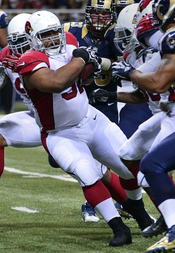 Sep 8, 2013; St. Louis, MO, USA; Arizona Cardinals nose tackle Dan Williams (92) intercepts a pass and scores a touchdown against the St. Louis Rams during the second half at Edward Jones Dome. The Rams defeated the Cardinals 27-24. Mandatory Credit: Scott Rovak-USA TODAY Sports