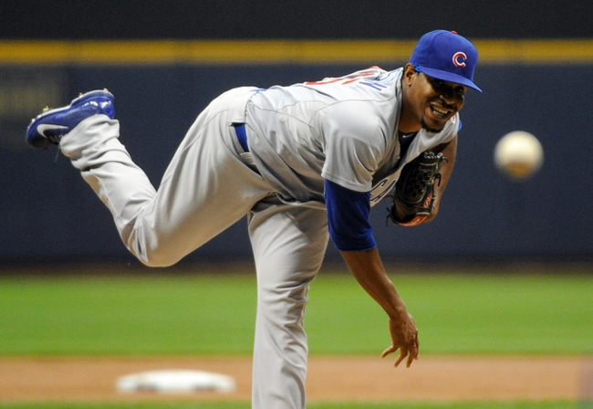 Sep 16, 2013; Milwaukee, WI, USA;  Chicago Cubs pitcher Edwin Jackson pitches against the Milwaukee Brewers in the first inning at Miller Park. Mandatory Credit: Benny Sieu-USA TODAY Sports
