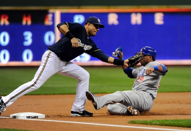 Sep 16, 2013; Milwaukee, WI, USA;  Milwaukee Brewers third baseman Aramis Ramirez tags out Chicago Cubs third baseman Luis Valbuena (right) trying to steal 3rd base in the first inning at Miller Park. Mandatory Credit: Benny Sieu-USA TODAY Sports