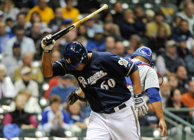 Sep 16, 2013; Milwaukee, WI, USA;  Milwaukee Brewers pitcher Wily Peralta reacts after striking out with the bases loaded in the second inning during the game against the Chicago Cubs at Miller Park. Mandatory Credit: Benny Sieu-USA TODAY Sports
