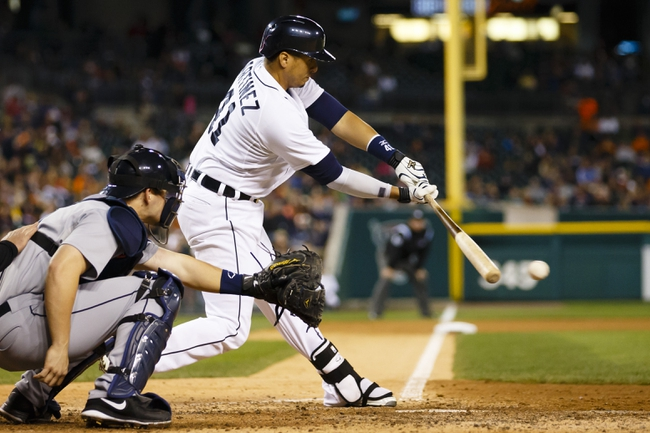 Sep 16, 2013; Detroit, MI, USA; Detroit Tigers designated hitter Victor Martinez (41) hits an RBI single in the sixth inning against the Seattle Mariners at Comerica Park. Mandatory Credit: Rick Osentoski-USA TODAY Sports