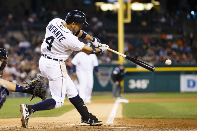 Sep 16, 2013; Detroit, MI, USA; Detroit Tigers second baseman Omar Infante (4) hits an RBI single in the sixth inning against the Seattle Mariners at Comerica Park. Mandatory Credit: Rick Osentoski-USA TODAY Sports