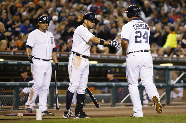 Sep 16, 2013; Detroit, MI, USA; Detroit Tigers third baseman Miguel Cabrera (24) is congratulated by second baseman Omar Infante (4) and left fielder Matt Tuiasosopo (18) after scoring in the sixth inning against the Seattle Mariners at Comerica Park. Mandatory Credit: Rick Osentoski-USA TODAY Sports