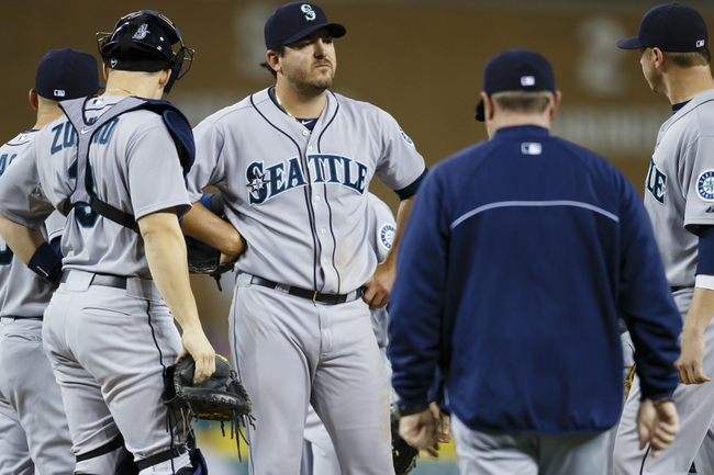 Sep 16, 2013; Detroit, MI, USA; Seattle Mariners manager Eric Wedge (22) walks out to the mound to relieve starting pitcher Joe Saunders (23) in the sixth inning against the Detroit Tigers at Comerica Park. Mandatory Credit: Rick Osentoski-USA TODAY Sports