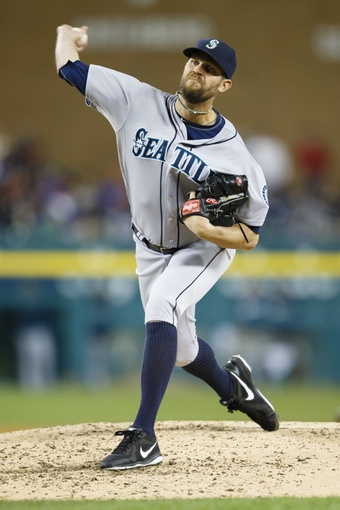 Sep 16, 2013; Detroit, MI, USA; Seattle Mariners relief pitcher Tom Wilhelmsen (54) pitches in the sixth inning against the Detroit Tigers at Comerica Park. Mandatory Credit: Rick Osentoski-USA TODAY Sports