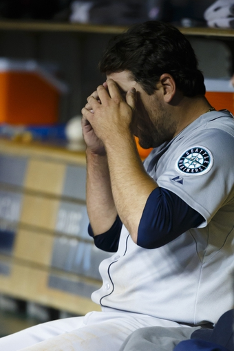 Sep 16, 2013; Detroit, MI, USA; Seattle Mariners starting pitcher Joe Saunders (23) sits in dugout after being relieved in the sixth inning against the Detroit Tigers at Comerica Park. Mandatory Credit: Rick Osentoski-USA TODAY Sports