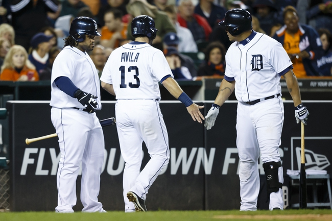 Sep 16, 2013; Detroit, MI, USA; Detroit Tigers catcher Alex Avila (13) is congratulated by first baseman Prince Fielder (28) and third baseman Miguel Cabrera (24) after scoring in the seventh inning against the Seattle Mariners at Comerica Park. Mandatory Credit: Rick Osentoski-USA TODAY Sports