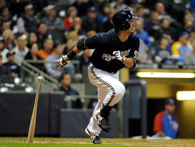 Sep 16, 2013; Milwaukee, WI, USA; Milwaukee Brewers right fielder Norichika Aoki beats out an infield hit and advances to 2nd base on a throwing error by Chicago Cubs shortstop Starlin Castro (not pictured) in the third inning at Miller Park. Mandatory Credit: Benny Sieu-USA TODAY Sports