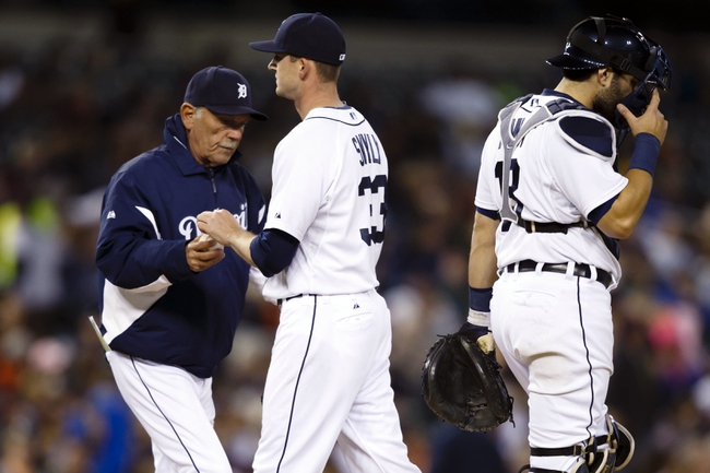 Sep 16, 2013; Detroit, MI, USA; Detroit Tigers manager Jim Leyland (10) takes the ball to relieve relief pitcher Drew Smyly (33) in the eighth inning against the Seattle Mariners at Comerica Park. Mandatory Credit: Rick Osentoski-USA TODAY Sports