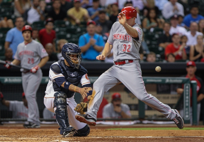 Sep 16, 2013; Houston, TX, USA; Cincinnati Reds right fielder Jay Bruce (32) scores a run during the fourth inning as Houston Astros catcher Carlos Corporan (22) attempts to field the throw at Minute Maid Park. Mandatory Credit: Troy Taormina-USA TODAY Sports