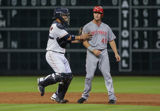 Sep 16, 2013; Houston, TX, USA; Houston Astros catcher Carlos Corporan (22) tags Cincinnati Reds designated hitter Ryan Ludwick (48) during the fourth inning at Minute Maid Park. Mandatory Credit: Troy Taormina-USA TODAY Sports