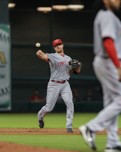 Sep 16, 2013; Houston, TX, USA; Cincinnati Reds shortstop Zack Cozart (2) throws to first base during the fourth inning against the Houston Astros at Minute Maid Park. Mandatory Credit: Troy Taormina-USA TODAY Sports