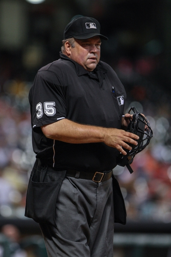 Sep 16, 2013; Houston, TX, USA; Home plate umpire Wally Bell stands between innings of a game between the Houston Astros and the Cincinnati Reds at Minute Maid Park. Mandatory Credit: Troy Taormina-USA TODAY Sports
