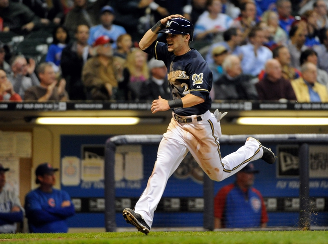 Sep 16, 2013; Milwaukee, WI, USA;  Milwaukee Brewers second baseman Scooter Gennett scores on a triple by left fielder Caleb Gindl (not pictured) in the fourth inning during the game against the Chicago Cubs at Miller Park. Mandatory Credit: Benny Sieu-USA TODAY Sports