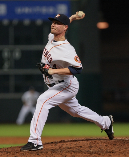 Sep 16, 2013; Houston, TX, USA; Houston Astros starting pitcher Lucas Harrell (64) delivers a pitch during the fifth inning against the Cincinnati Reds at Minute Maid Park. Mandatory Credit: Troy Taormina-USA TODAY Sports