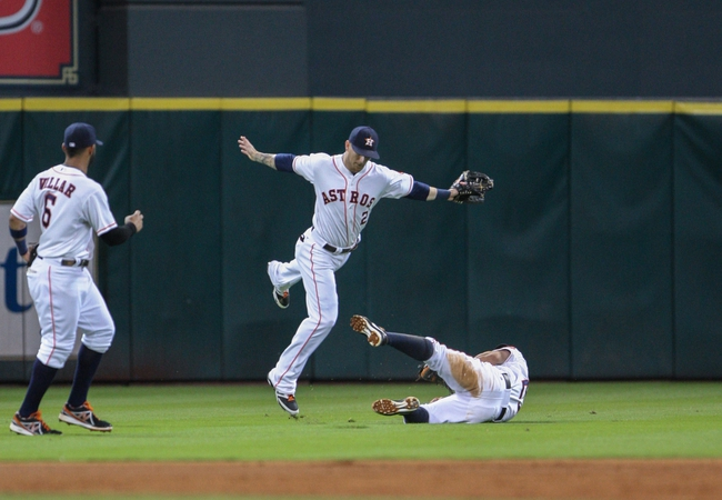 Sep 16, 2013; Houston, TX, USA; Houston Astros center fielder Brandon Barnes (2) and second baseman Jose Altuve (27) attempt to catch a fly ball during the fifth inning against the Cincinnati Reds at Minute Maid Park. Mandatory Credit: Troy Taormina-USA TODAY Sports