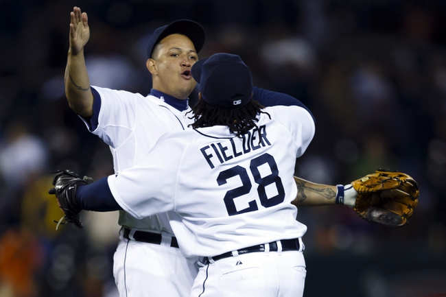 Sep 16, 2013; Detroit, MI, USA; Detroit Tigers third baseman Miguel Cabrera (24) and first baseman Prince Fielder (28) celebrate after the game against the Seattle Mariners at Comerica Park. Detroit won 4-2. Mandatory Credit: Rick Osentoski-USA TODAY Sports