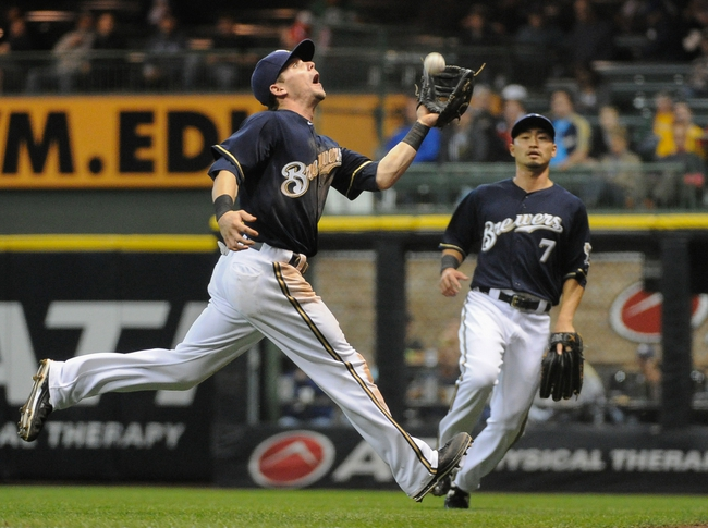 Sep 16, 2013; Milwaukee, WI, USA;  Milwaukee Brewers second baseman Scooter Gennett can't catch a ball hit by Chicago Cubs catcher Welington Castillo (not pictured) that was ruled a double in the fifth inning at Miller Park. Mandatory Credit: Benny Sieu-USA TODAY Sports