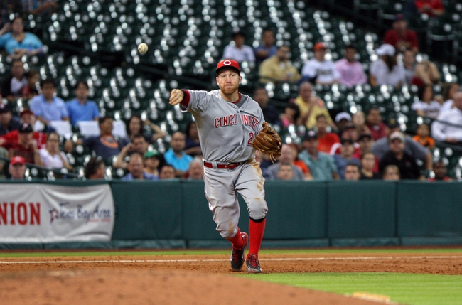 Sep 16, 2013; Houston, TX, USA; Cincinnati Reds third baseman Todd Frazier (21) throws to first base during the sixth inning against the Houston Astros at Minute Maid Park. Mandatory Credit: Troy Taormina-USA TODAY Sports