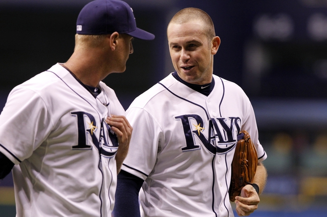 Sep 16, 2013; St. Petersburg, FL, USA; Tampa Bay Rays third baseman Evan Longoria (3) talks with starting pitcher Alex Cobb (53) as they walk back to the dugout after he pitched the seventh inning against the Texas Rangers at Tropicana Field. Tampa Bay Rays defeated the Texas Rangers 6-2. Mandatory Credit: Kim Klement-USA TODAY Sports