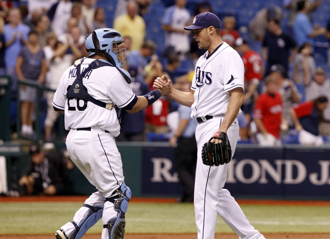 Sep 16, 2013; St. Petersburg, FL, USA; Tampa Bay Rays catcher Jose Molina (28) and relief pitcher Jamey Wright (35) congratulate each other after they beat the Texas Rangers at Tropicana Field. Tampa Bay Rays defeated the Texas Rangers 6-2. Mandatory Credit: Kim Klement-USA TODAY Sports